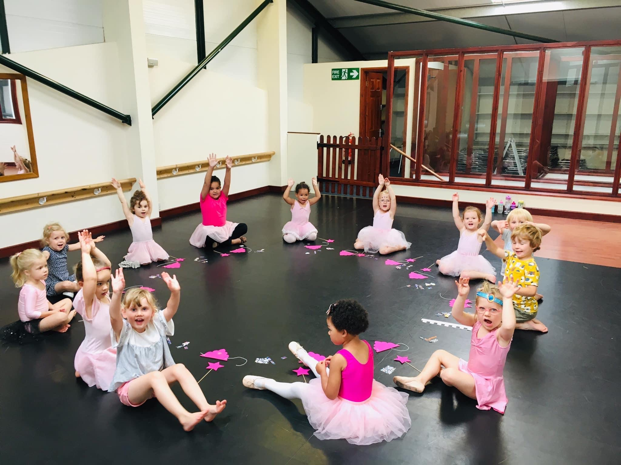 ballet class, large circle hands raised
