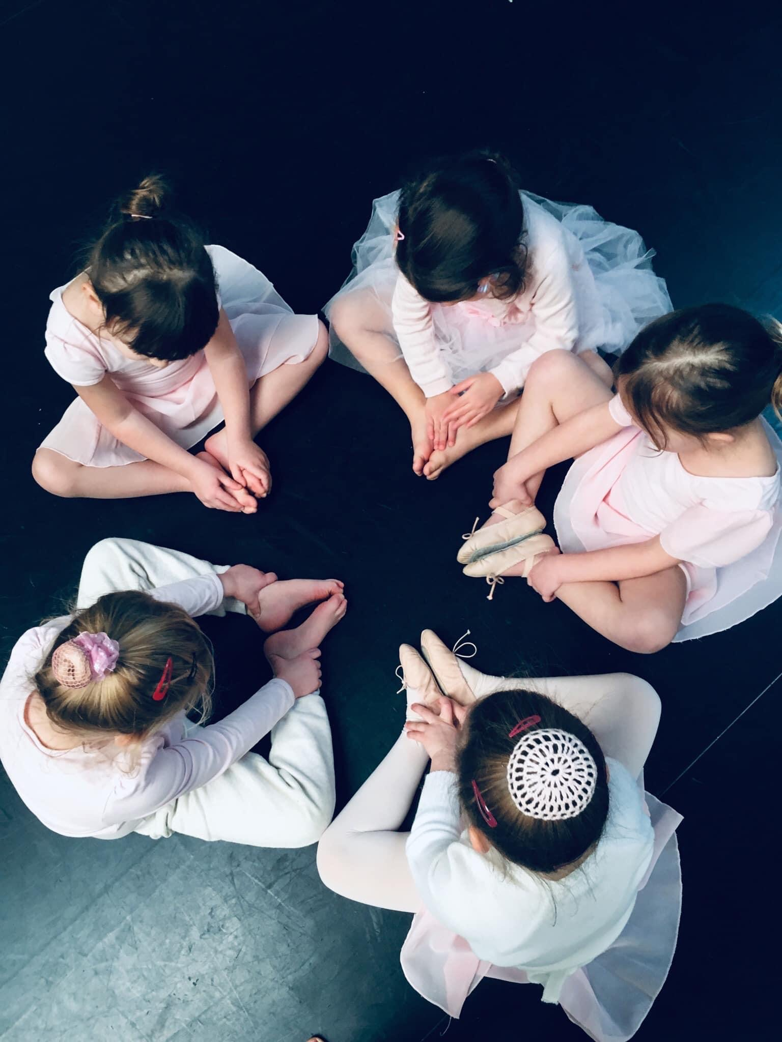 ballet class seated feet together